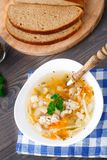 Bowl of chicken soup with vegetables and noodles Royalty Free Stock Image