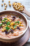 Bowl of chickpea soup on the wooden table Stock Images