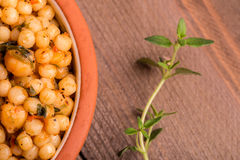 Bowl of chickpeas with herbs Royalty Free Stock Image