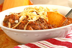 Bowl of Chili. With shredded cheese and tortilla chip Stock Photo