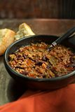 Bowl of Chili con carne. Bowl of chlli with bread in background Stock Photos