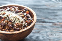 Bowl of chili con carne. On the wooden table royalty free stock photo