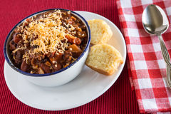 Bowl of Chili With Corn Bread Muffin Close Up. Bowl of warm chili winter comfort food with corn bread muffin close up Stock Images