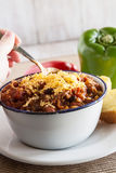 Bowl of Chili With Corn Bread Muffin Hand Scooping Royalty Free Stock Images
