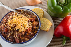 Bowl of Chili With Corn Bread Muffin Peppers And Onion Stock Photography