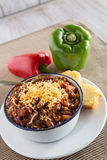 Bowl of Chili With Corn Bread Muffin And Peppers Vertical Royalty Free Stock Image