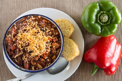 Bowl of Chili With Corn Bread Muffin And Peppers Stock Photo