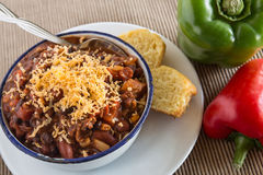 Bowl of Chili With Corn Bread Muffin Red Green Pepper Stock Photos