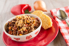 Bowl of Chili With Corn Bread Muffin And Vegetables Stock Photos