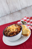 Bowl of Chili With Corn Bread Muffin Vertical Royalty Free Stock Images