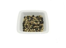 Bowl of chinaware with pepper corns Stock Images