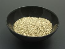 Bowl of chinaware with quinoa. On a dull matting stock photo