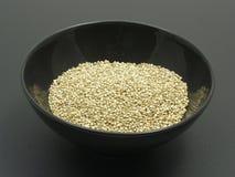 Bowl of chinaware with quinoa Stock Photo