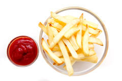 Bowl of chips and ketchup from above Stock Images