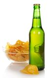 Bowl with chips and wet bottle of beer Stock Photography