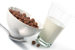 Bowl with chocolate balls and glass of milk Stock Images