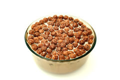 Bowl with Chocolate Balls and Milk Royalty Free Stock Photography