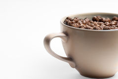 Bowl of Chocolate Cereal. A large mug with a handle containing chocolate puffed cereal and milk Royalty Free Stock Photo