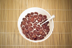 Bowl of chocolate cereals Stock Images