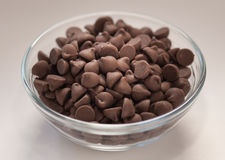 Bowl of chocolate chips. Glass bowl of chocolate chips Stock Photos
