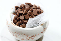 Bowl of chocolate chips Stock Images