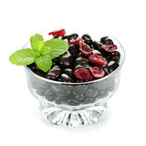 Bowl of chocolate coated cranberries Stock Photography