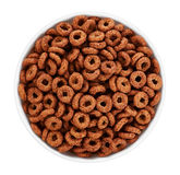 Bowl with chocolate corn rings isolated on white background. Cer Stock Images