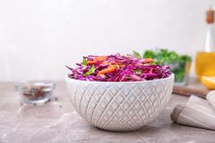 Bowl with chopped red cabbage. On table stock photo