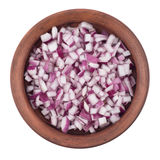 Bowl of chopped red onion on white background. Stock Photography