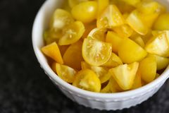Bowl of Chopped Yellow Tomatoes Stock Image