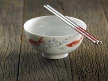 Bowl and chopstick Stock Photos