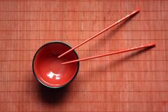 Bowl and chopsticks Stock Image