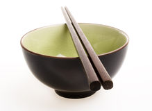 Bowl and Chopsticks. On white background Stock Photography