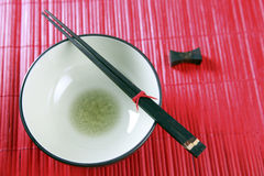 Bowl and chopsticks Stock Images