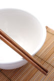 Bowl and chopsticks. A shot of bowl and chopsticks royalty free stock image