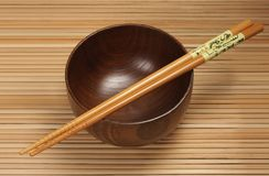 Bowl with chopsticks Stock Image