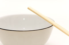 Bowl and chopsticks. Bowl and a couple of chopsticks Royalty Free Stock Image