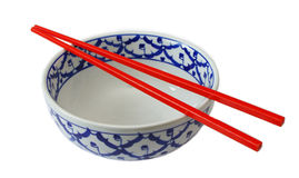 Bowl and Chopsticks. Red Chopsticks resting on an oriental bowl Stock Photography