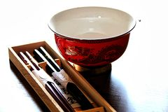 Bowl and chopsticks , all ready for a delicious meal. royalty free stock images