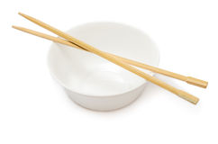 Bowl with chopsticks Stock Images