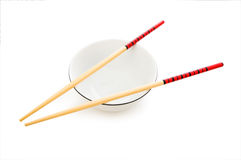 Bowl and chopsticks isolated Stock Photo