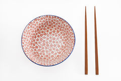 Bowl With Chopsticks Royalty Free Stock Images