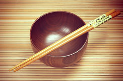 Bowl with chopsticks on the mat  background Royalty Free Stock Photo