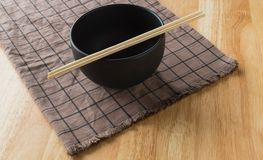 Bowl & chopsticks. Placed on tablecloth Royalty Free Stock Photo