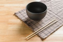 Bowl & chopsticks. Placed on tablecloth Royalty Free Stock Image