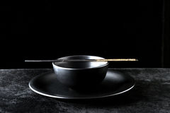 Bowl and chopsticks on a plate Stock Image