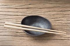 Bowl with chopsticks Royalty Free Stock Photo