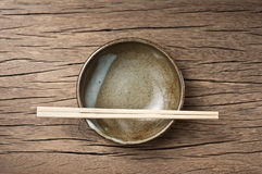 Bowl with chopsticks Royalty Free Stock Image