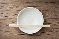 Bowl with chopsticks Royalty Free Stock Photos