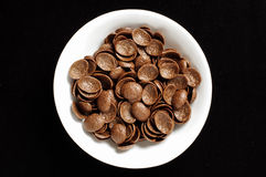 Bowl of chrispy chocolate crunch cornflakes isolated on the black background Stock Images